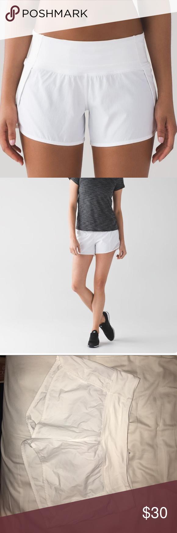 White lululemon shorts Lululemon white running shorts. Slightly longer fit. Worn once! Now too big for me lululemon athletica Shorts