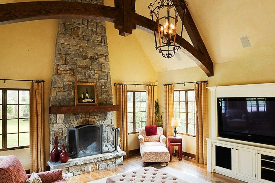French country style living room design in yellow, with a stone ...
