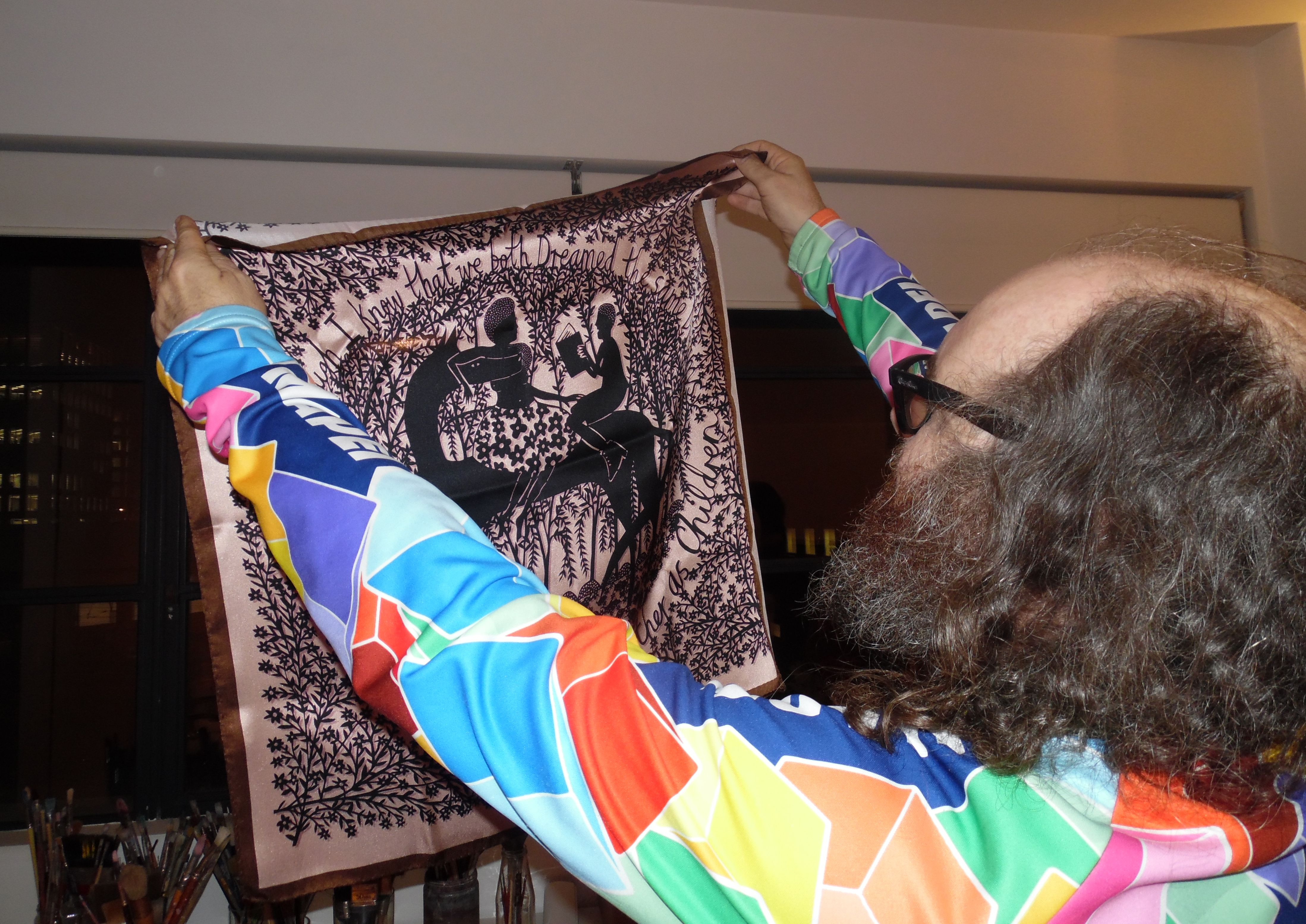 Rob Ryan admiring one of his thescarfgallery.com scarves.