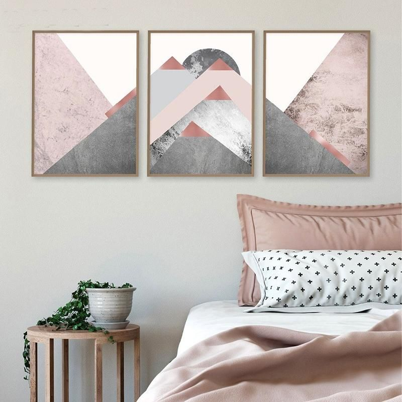 Gallery wall of pink and grey abstract mountain artwork in