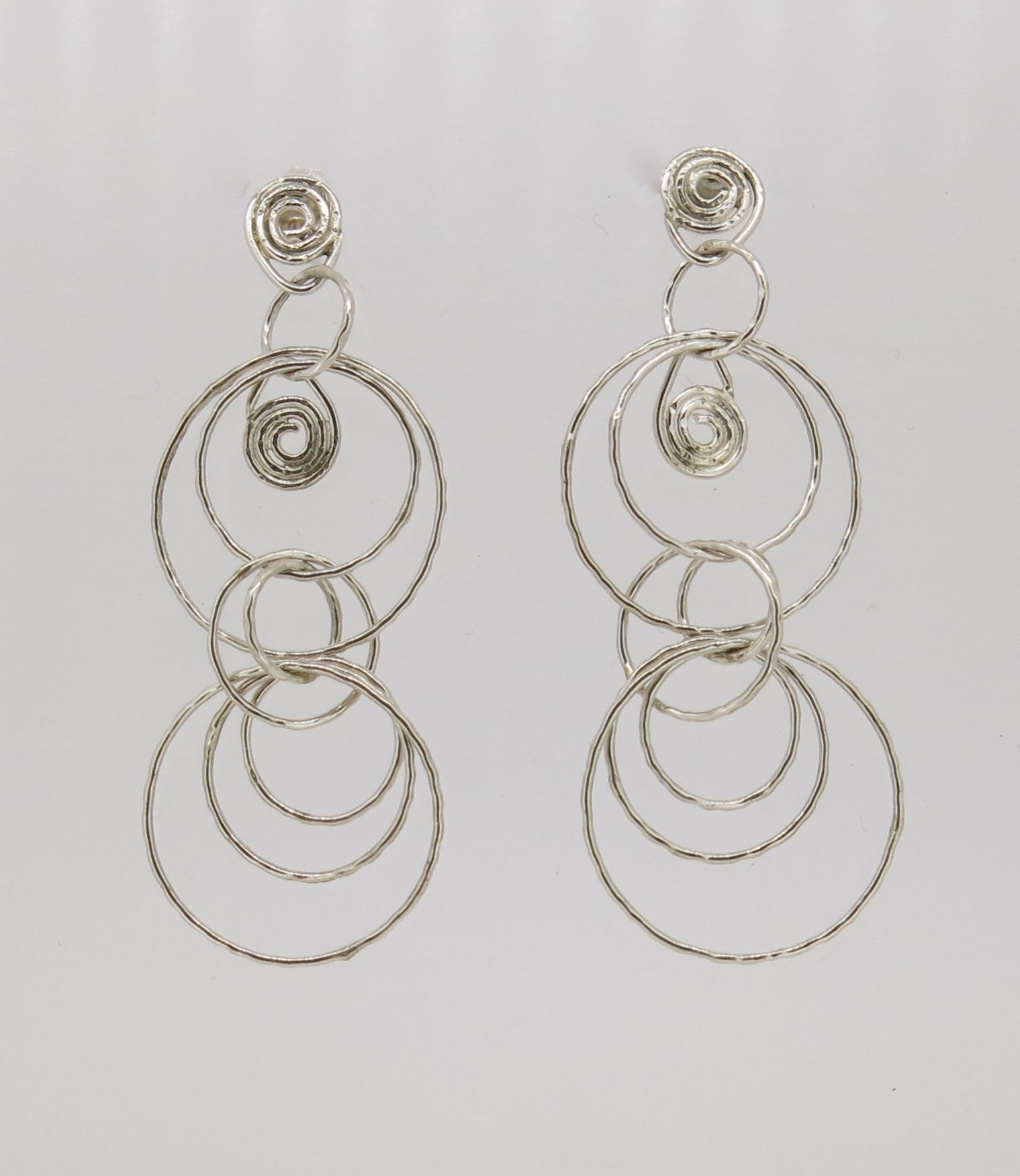 """""""Fine silver spirals"""" - these eye-catching earrings feature sterling silver rings (largest ring - 20mm diameter) and have a total drop of 60mm. Add them to your collection now for just $70(AUD) from mhoriginals.com.au ❤"""