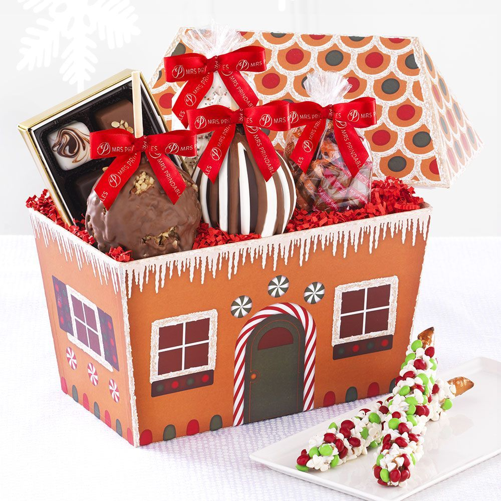 """Raise the roof to reveal 1 Triple Chocolate Petite Apple and 1 Milk Chocolate Walnut Petite Apple, 2 Chocolate Pretzels, a 4.5-oz. bag of Holiday Pretzel Bites, an assorted gift bag of exotic Natural Caramels and a quartet of Natural Chocolate Covered Caramels, featuring Banana Walnut, Coffeehouse Mocha, Hawaiian Red Sea Salt and Pomegranate Cherry flavors.  Gift size: 11"""" x 7"""" x 10"""" $49.99"""