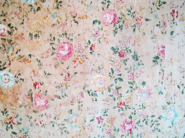 Floral wallpaper found on the wall under layers of paint in