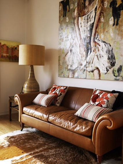 Warm Colors Leather Couch Giant Art And Lamp Hahah