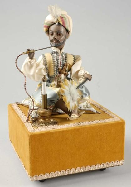 Turkish Man with Turban Automaton with Music Box - Head and arms move while playing two Turkish melodies.