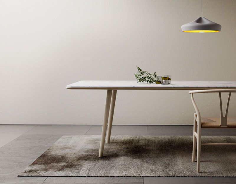 A Big Long Marble Table Provides An Elegant Place To Gather Around