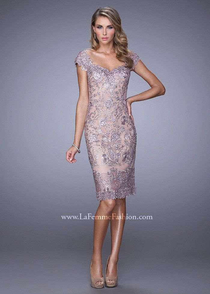 00fd8e370ecb A standout lace cocktail dress with a wide V neckline and back. The lace is  embellished with sparkling tonal rhinestones. Back zipper closure.Fabric   Lace