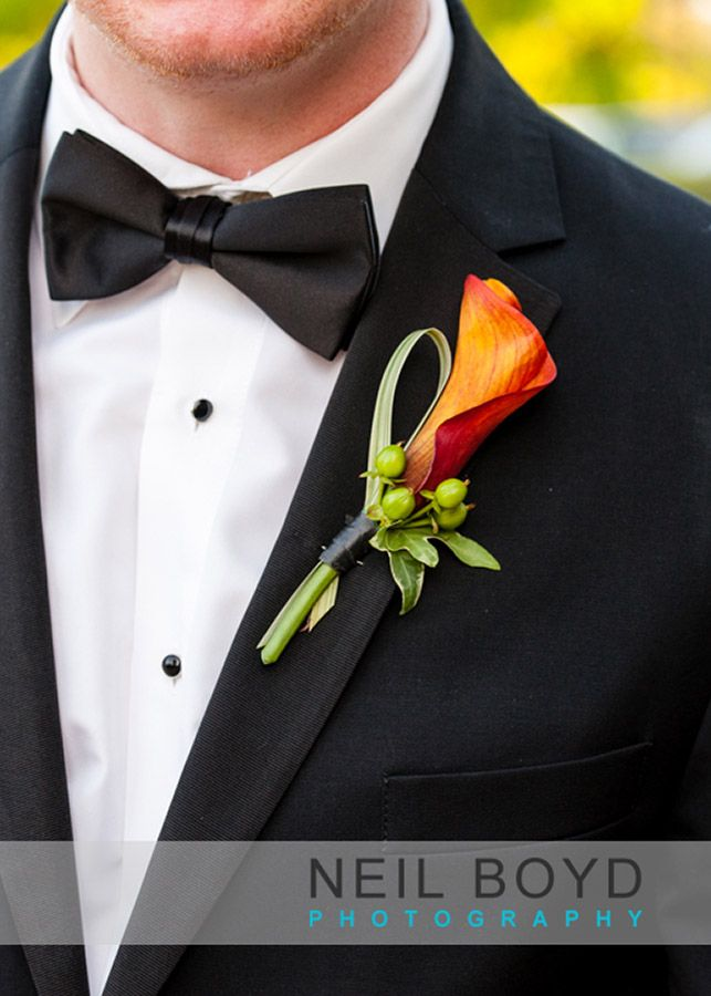 Orange flower boutonniere English Garden Florist in Raleigh NC