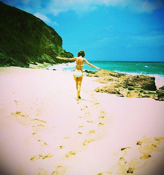 Taylor Swift hunts for Easter Eggs in a blue bikini