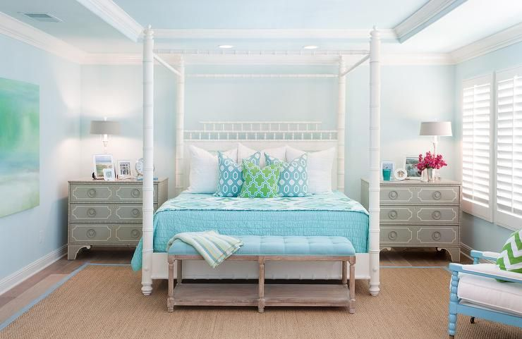 gray and blue cottage bedroom features a white faux bamboo canopy bed with pagoda headboard