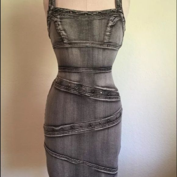 Looking for denim dress! This dress is by boom boom jeans and I am in love with it, I missed buying it off eBay and now trying to find another one size small- medium, or just looking for a jean dress with style like this and figure flattering! Boom boom Dresses