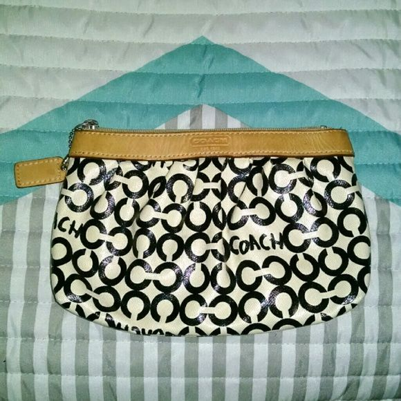 Authentic Coach Clutch Authentic Small Coach Clutch. Some staining on the inside. Coach Bags Clutches & Wristlets
