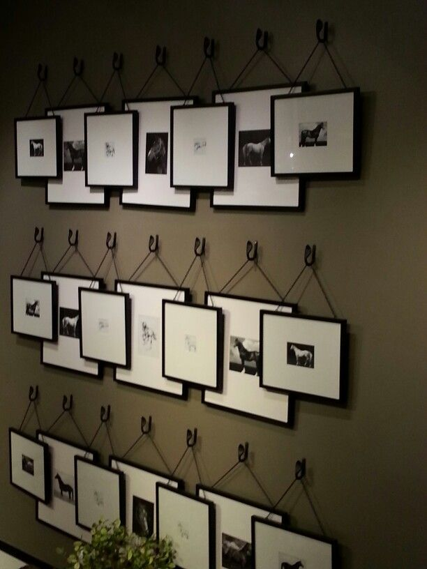 Unique idea for a gallery wall of stacking frames it makes it easy to switch something out and uses smaller frames