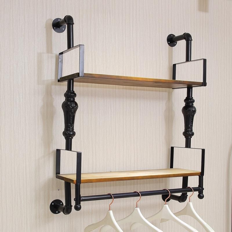 Wall Hangers For Clothes Fascinating Nicole Camry On A Wall Mounted Shelf Upscale Clothing Store Iron Inspiration Design