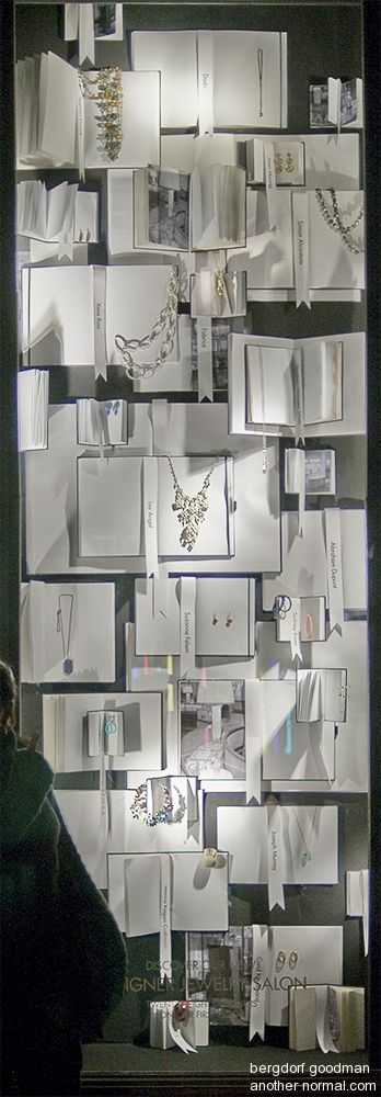displaying jewelry on books in window. Or get thrift store books, white paper, inspirational quotes, resolutions...