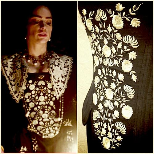 Close up of white embroidered black silk dress from season 2