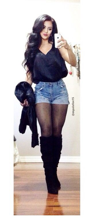 black shirt with denim jean shorts and knee high boots