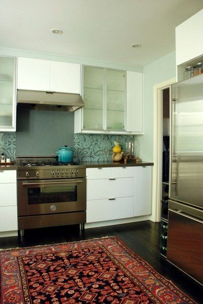 Ten Kitchen Improvements for Renters Put small oriental rug in mostly white kitchen