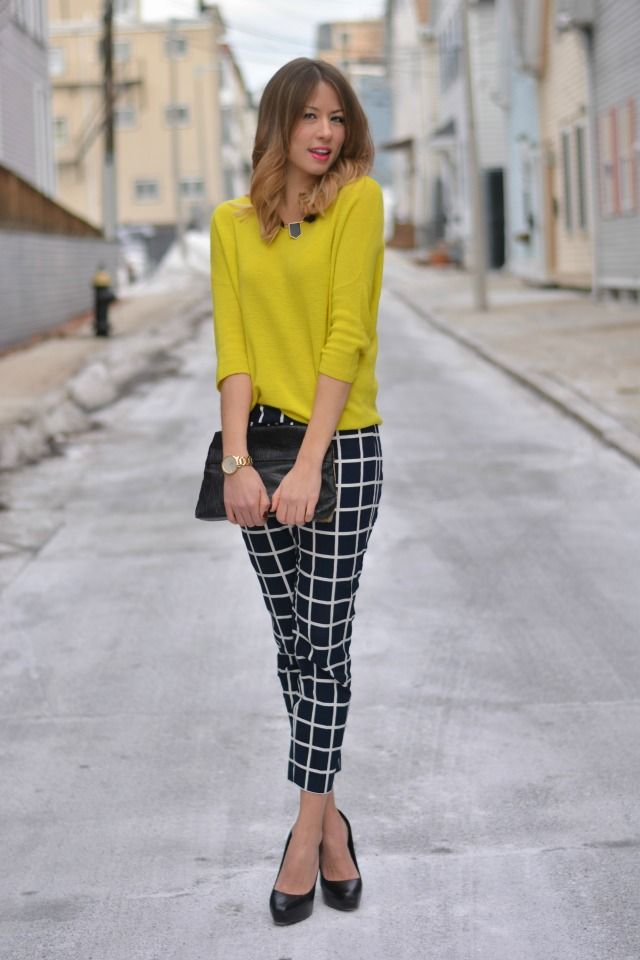 0c54688675 A color such as yellow creates a fun look with a pair of black and white  pants.