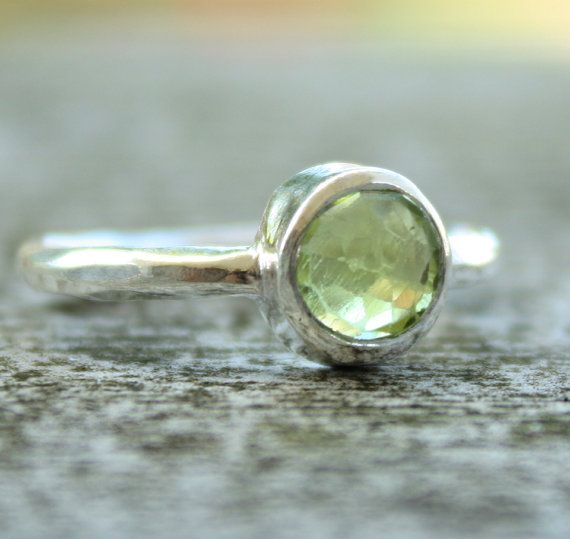 not a whole lot of jewelry catches my attention, but i love this ring.  could be almost any stone.