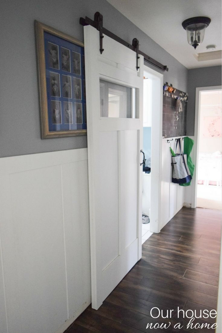 A sliding barn door is created to add function to this small space