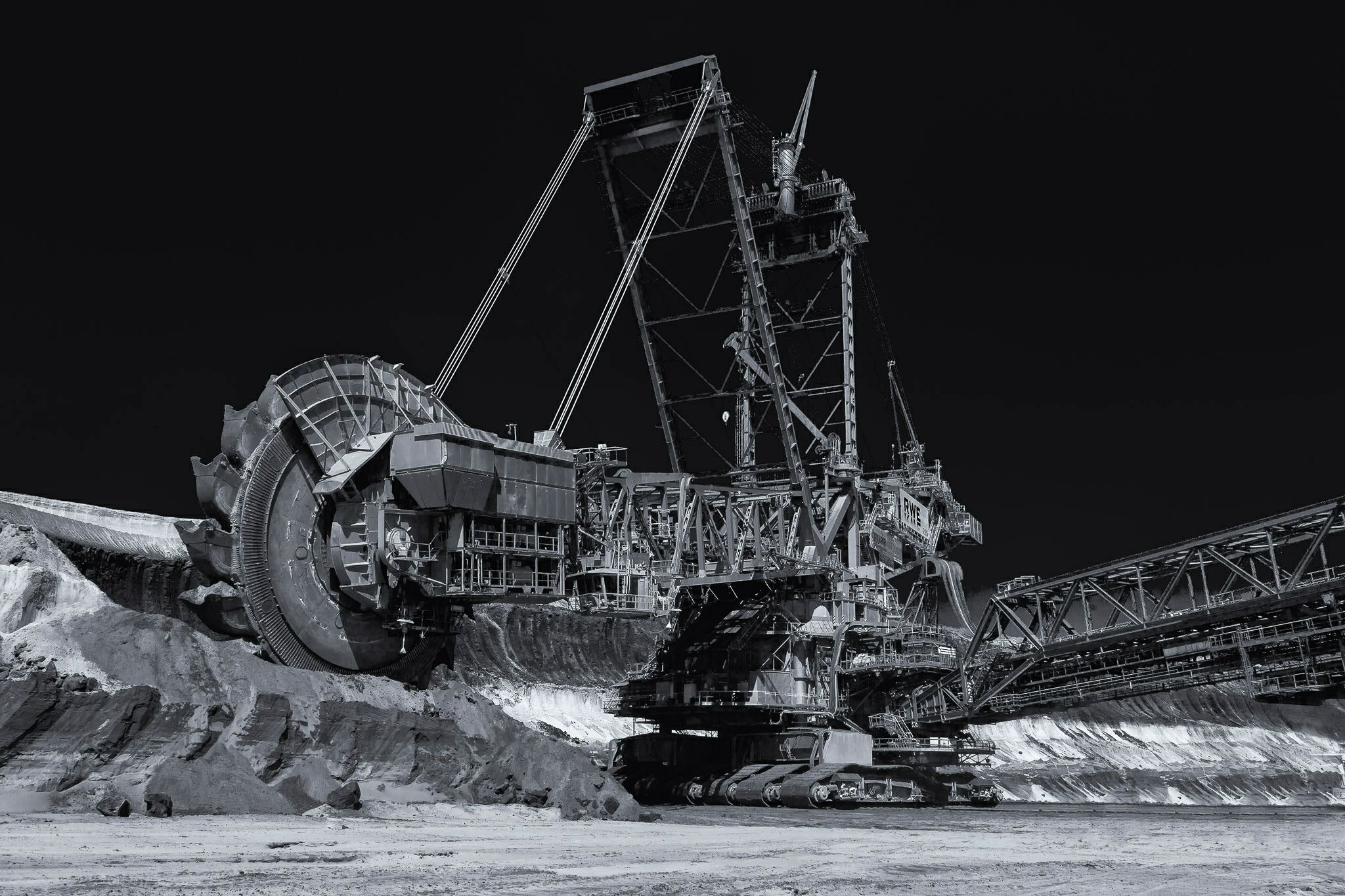 https://flic.kr/p/dHvLej | gentle giant | Partial view of a behemoth bucket-wheel excavator eating up the lignite strata at Garzweiler II open-cast mine, Germany.