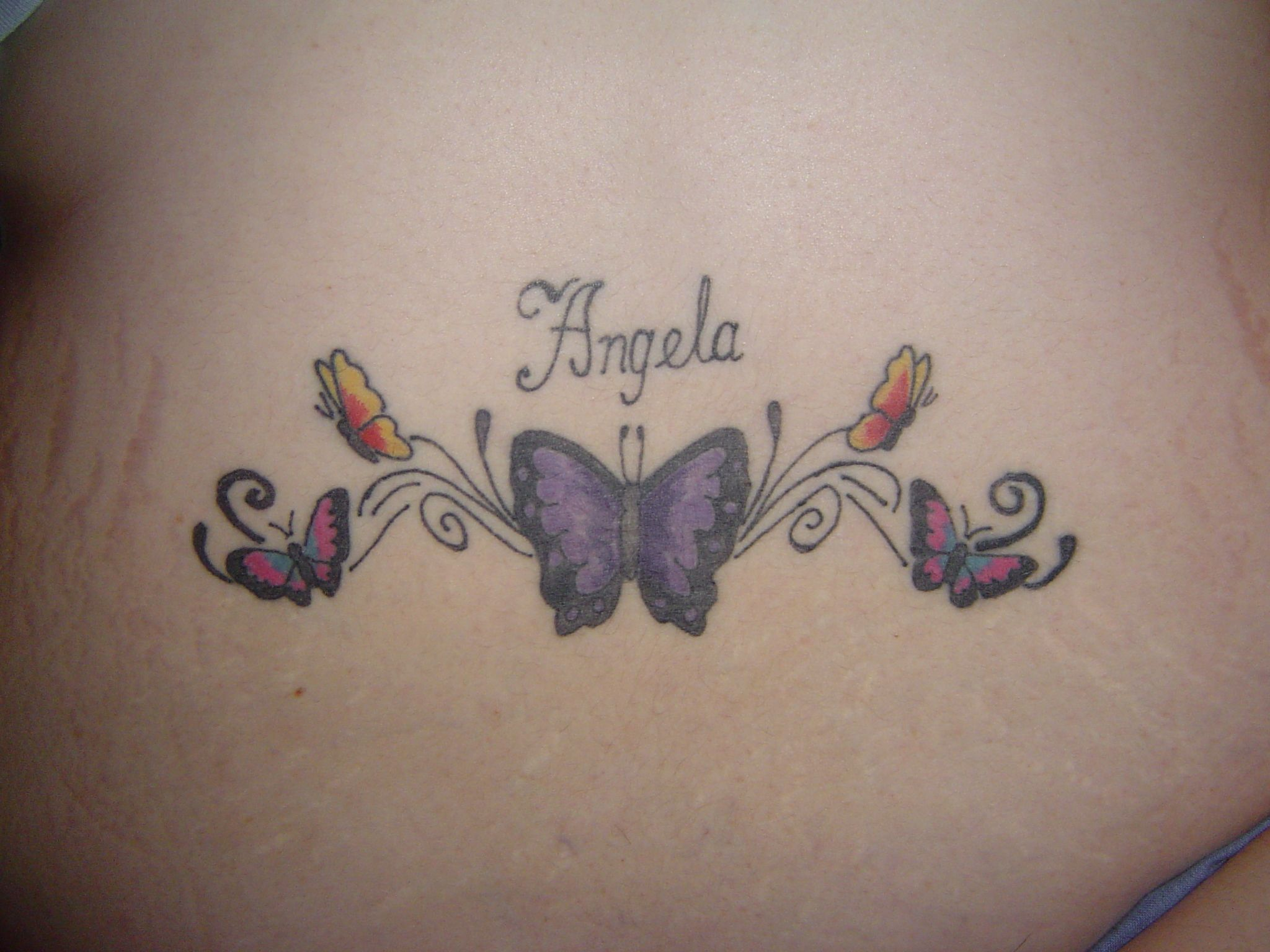 Pictures of tattoos for women and beautiful women lower back