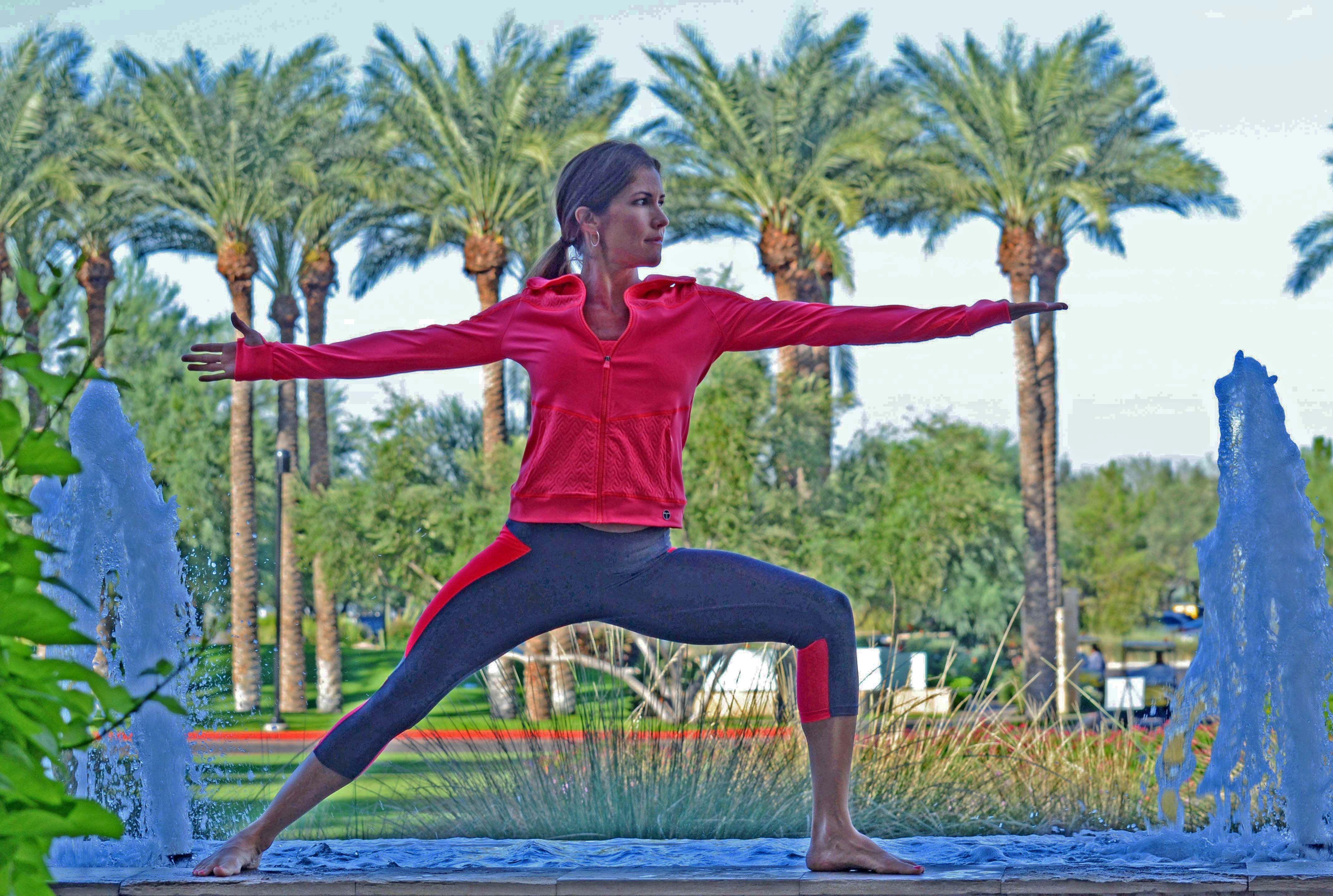 Great into your warrior pose with the beautiful palm tree backdrop at our front circle drive. Outfit can be purchased at Revive Spa Boutique.
