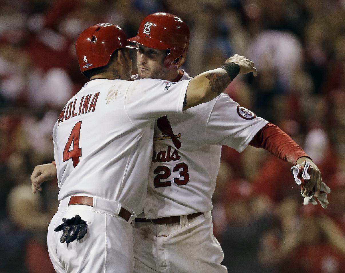 St. Louis Cardinals' David Freese and Yadier Molina