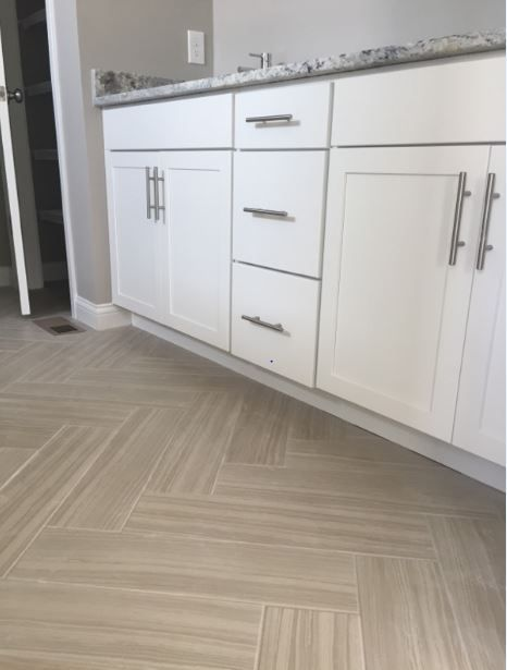 Santino Chiaro 6x24 Tile Installed In Herringbone Pattern On
