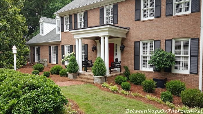 A Front Yard Makeover With Boxwood Shrubs Benches 400 x 300
