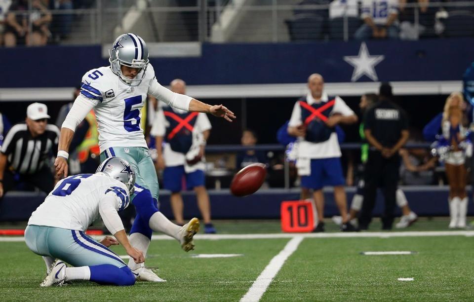 d91de19a7 Cowboys - Dallas Cowboys punter Chris Jones holds while kicker Dan Bailey  makes the kick (9 13 15)