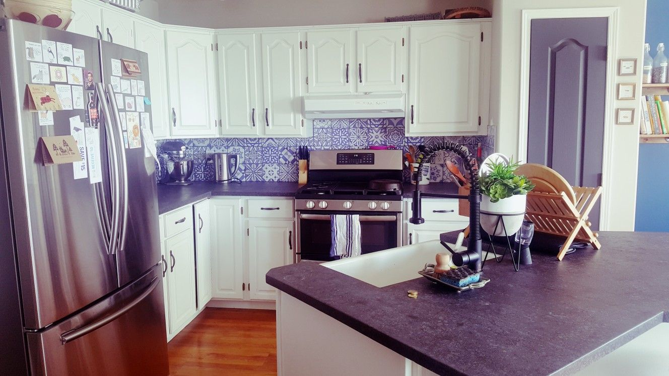 Oak cabinets painted white. Lisbon tiles as backsplash ...