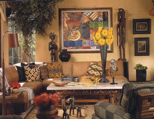 Here colorful African prints on pillows accent a couch with clean ...