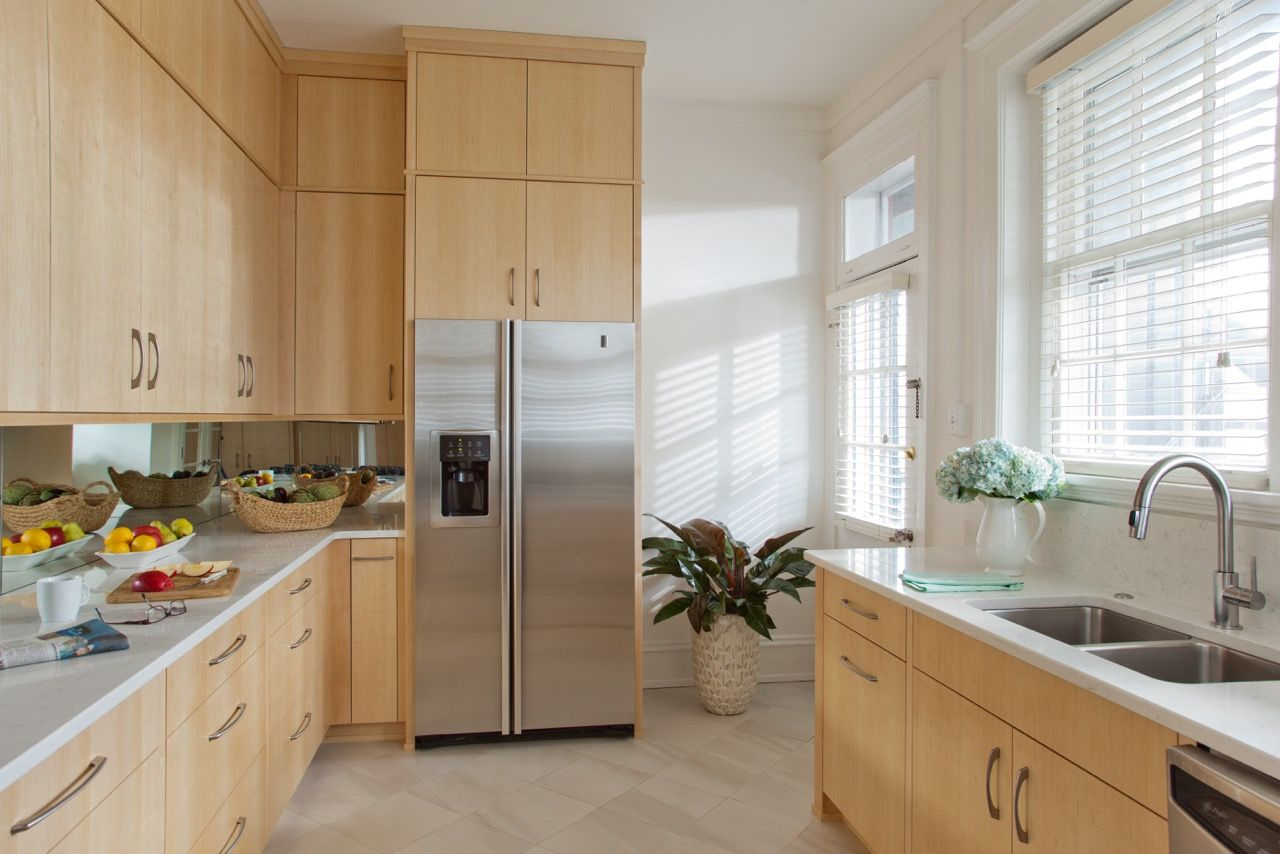 This sleek kitchen features custom made quarter sawn maple ... on Modern Kitchen Backsplash With Maple Cabinets  id=27127