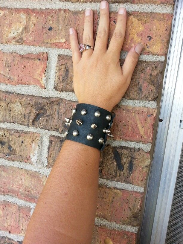 Spiked and studded leather bracelet made from leather motorcycle saddlebags
