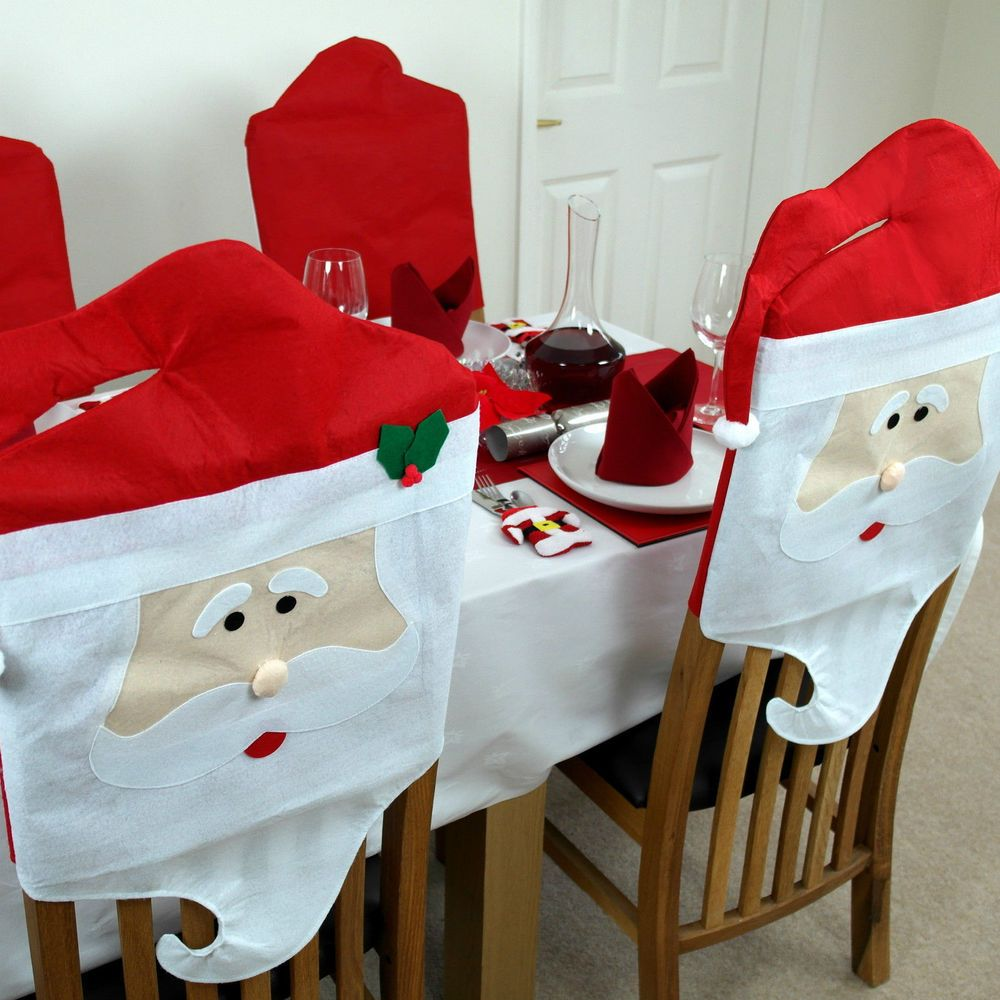 If you're not exactly dining in the lap of luxury, at least you will be dining in the lap of the holiday's most fun and celebrated couple. Transform your dining room chairs and your home for the Christmas with this 2 Piece Christmas Chair Cover. Slips easily over the backs of side chairs to create an effect that's sure to impress your guests.