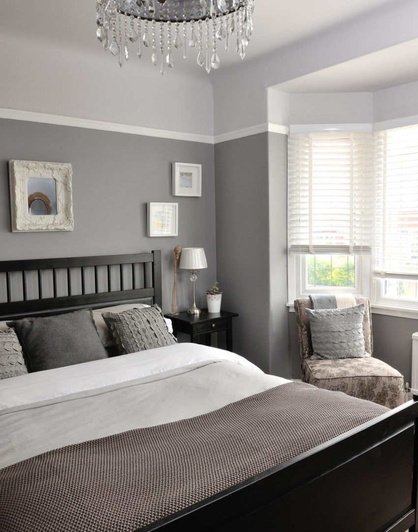 Different tones of grey give this bedroom a unique and interesting