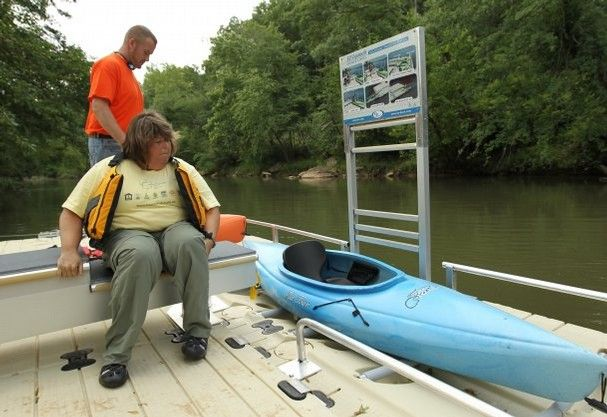 EZ Launch ADA Transfer System On Floating Kayak Ramp In Use At Dolly Cooper  Park In