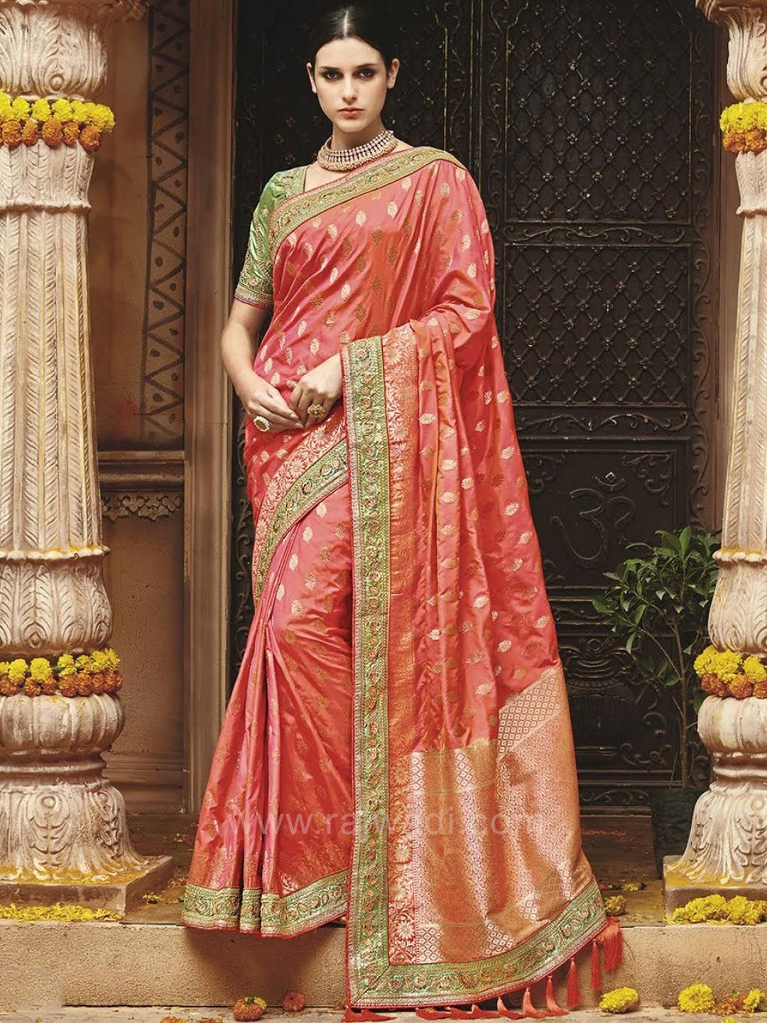 8a323d5e559c39 ... Silk fabric Saree in Neon Coral color is enhanced with heavy embroidery  work having tassels on pallu. Available with contrast Light Green Silk  blouse.