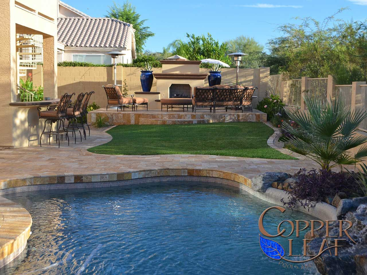 pool remodel gold travertine pavers barbecue bar fireplace
