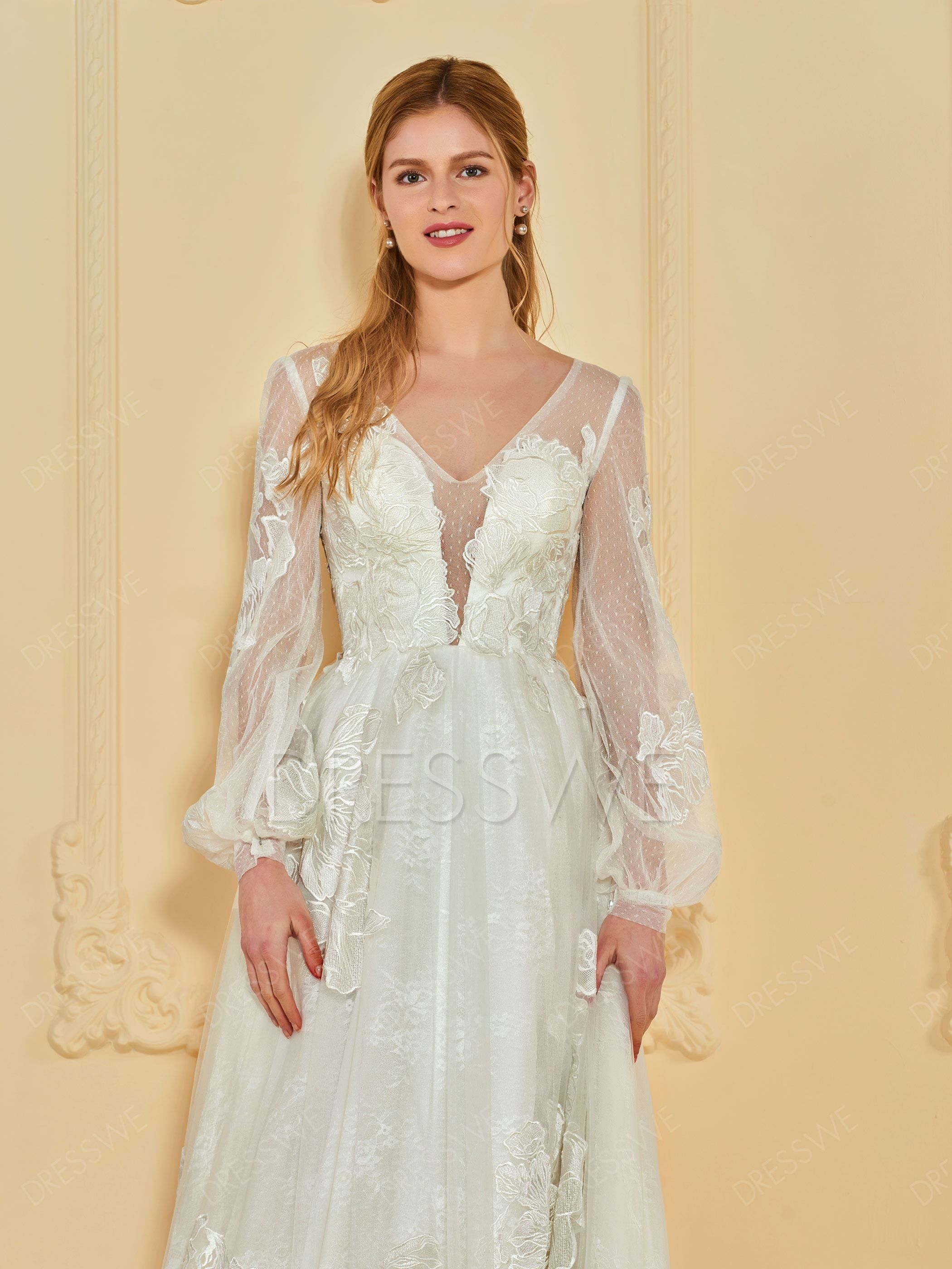 Lace appliques long sleeve wedding dress in our fiftieth