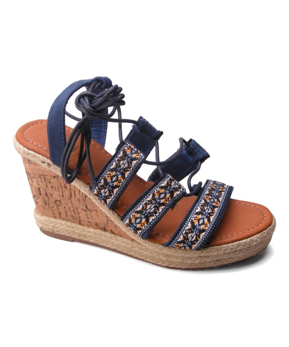 f1c62a8452c4 Take a look at this Navy Shiloh Boho Wedge Sandal today!