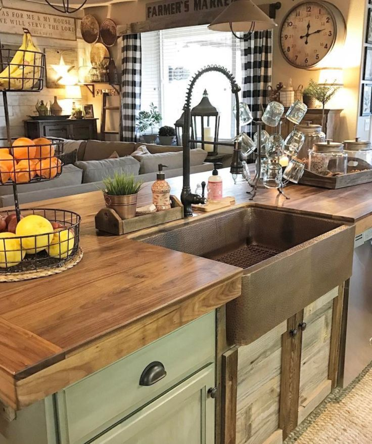 I love this copper apron sink, especially with the green cabinets and darker faucet. Plus, the doors under the sink bring in some of the rustic barn wood, without having to do all the cabinets with barn wood. #kitchen
