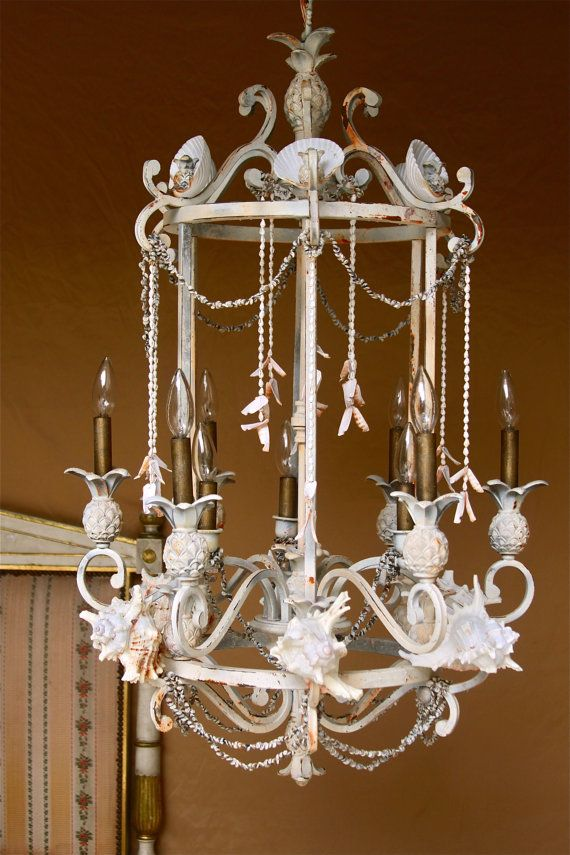 Large chandelier with shells in dirty white.