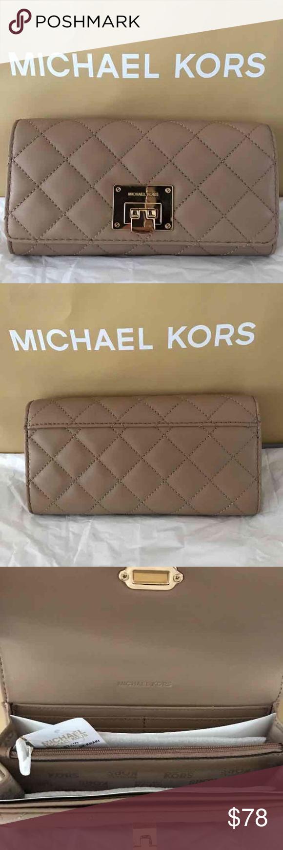 8e473e5e4a9232 Michael Kors Astrid Carryall Wallet • New with tag authentic Michael Kors  astrid carryall wallet in dark khaki. • Gold tone hardware.