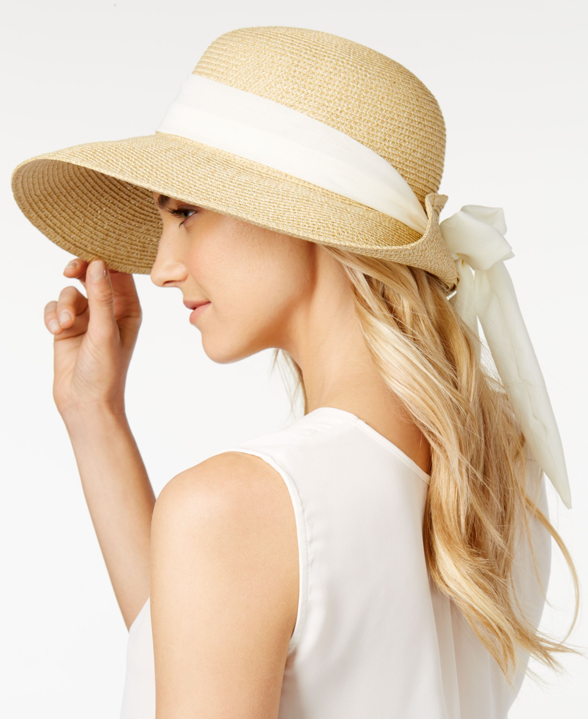 0a359223a995b Say hello to a full season of chic looks with Nine West s packable sun hat