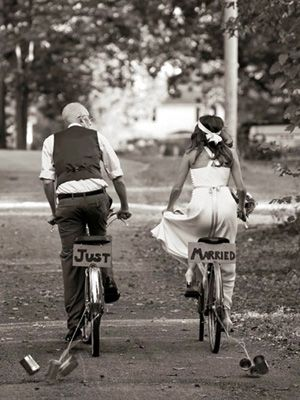 This would be so cute since you have a bike in your engagement pictures! I love the tin cans tied on the bicycles! Basically, I freaking adore this picture. <3