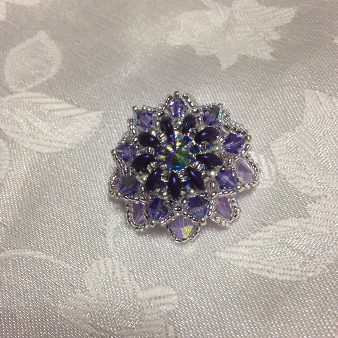pendente ( fiore)  con swarovski  toni viola argento
