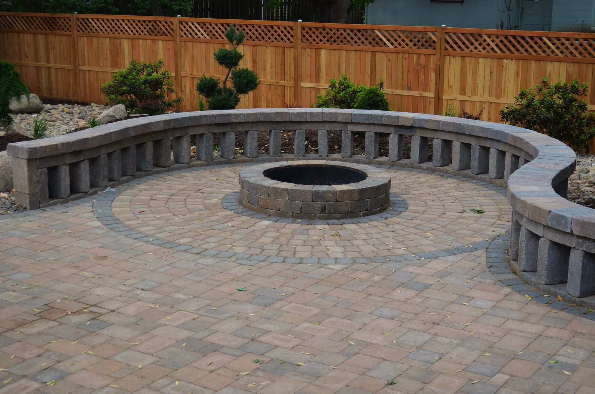 Gorgeous backyard patio with built-in fire pit and curved ...